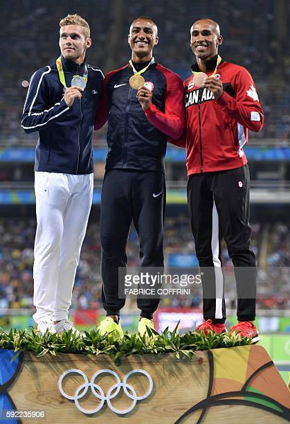 France's Kevin Mayer USA's Ashton Eaton and Canada's Damian Warner pose during the podium ceremony for the Men's Decathlon during the athletics event...
