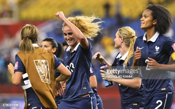 France's Kheira Hamraoui Amanadine Henry and Wendie Renard celebrates the team's 30 victory over South Korea in a 2015 FIFA Women's World Cup round...