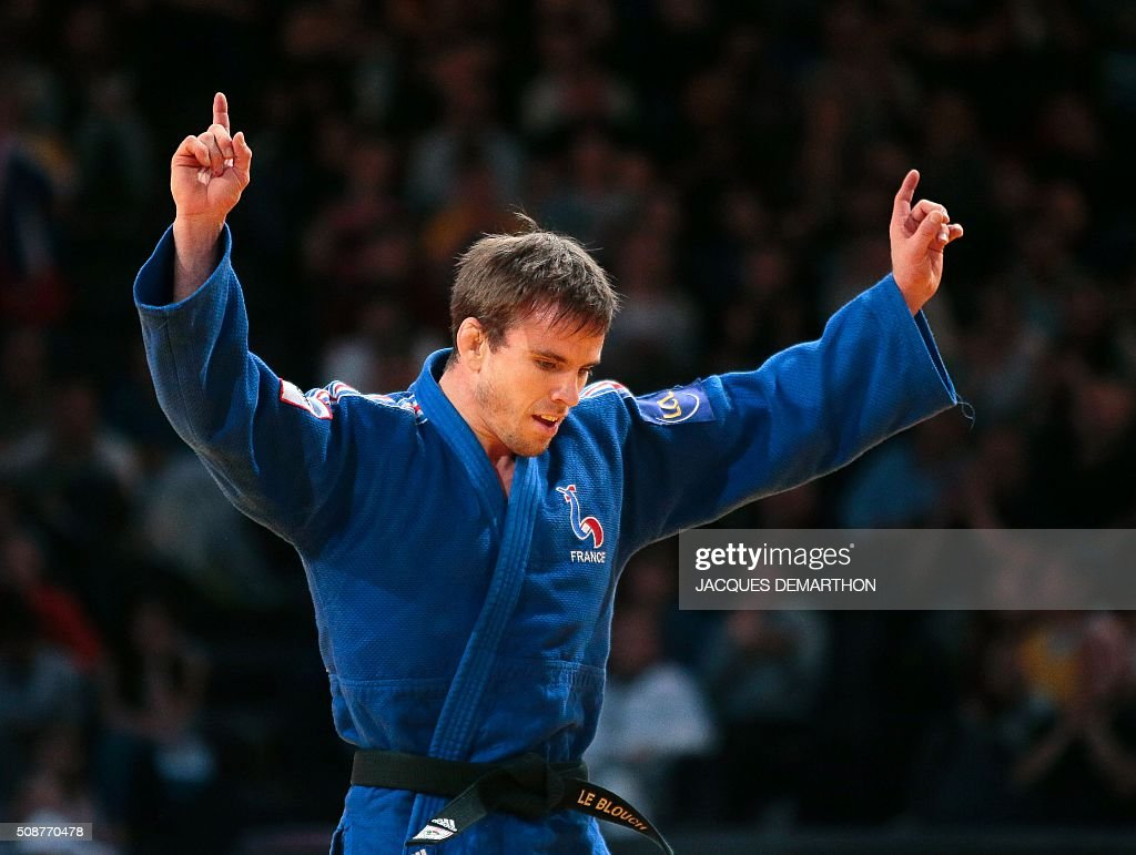 France's Kilian Le Blouch celebrates beating South Korea's Kim Limhwan in the men's under 66 kg bronze medal fight of the Paris Grand Slam Judo tournament on February 6, 2016 in Paris. / AFP / JACQUES DEMARTHON