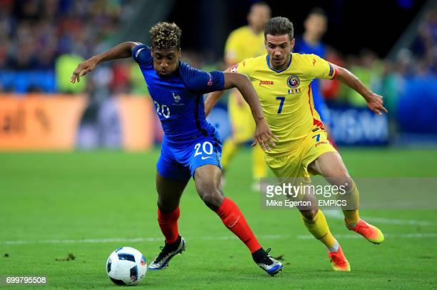 France's Kingsley Coman and Romania's Alexandru Chipciu battle for the ball