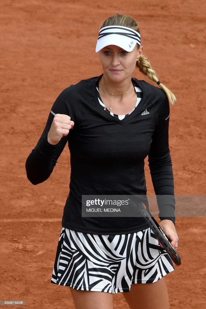 France's Kristina Mladenovic celebrates after winning a point against Italy's Francesca Schiavone during their women's first round match at the Roland Garros 2016 French Tennis Open in Paris on May 24, 2016. / AFP / MIGUEL