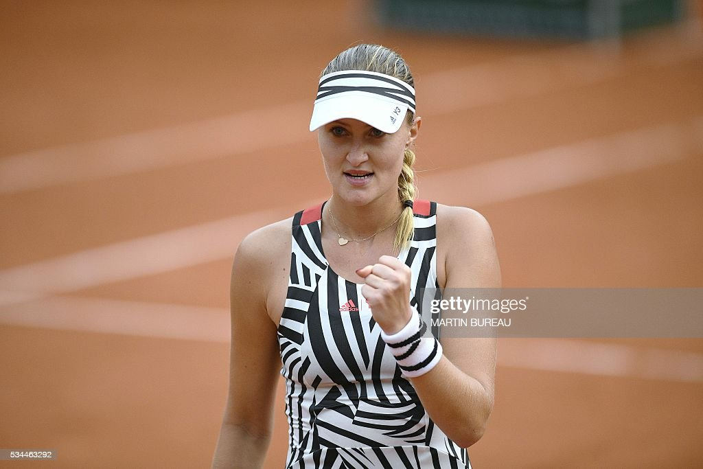 France's Kristina Mladenovic celebrates after winning her women's second round match against Hungary's Timea Babos at the Roland Garros 2016 French Tennis Open in Paris on May 26, 2016. / AFP / MARTIN