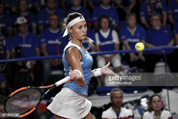 France's Kristina Mladenovic competes against Spanish player Sara Sorribes Tormo during the Fed Cup tennis match between France and Spain in Roanne...