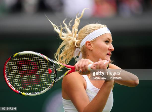 France's Kristina mladenovic in action against Russia's Maria Sharapova during day one of the Wimbledon Championships at The All England Lawn Tennis...