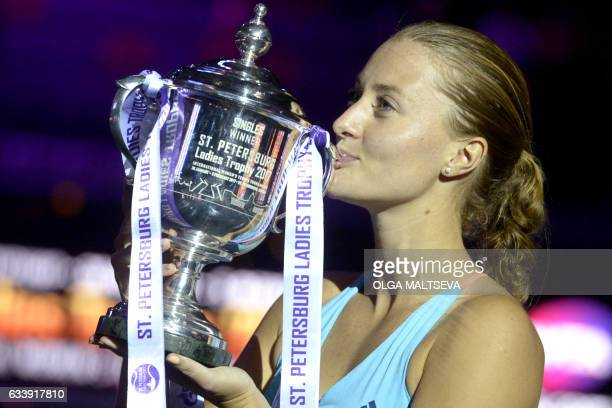 France's Kristina Mladenovic kisses her trophy after the final match of the WTA St Petersburg Ladies Trophy 2017 tennis tournament against...