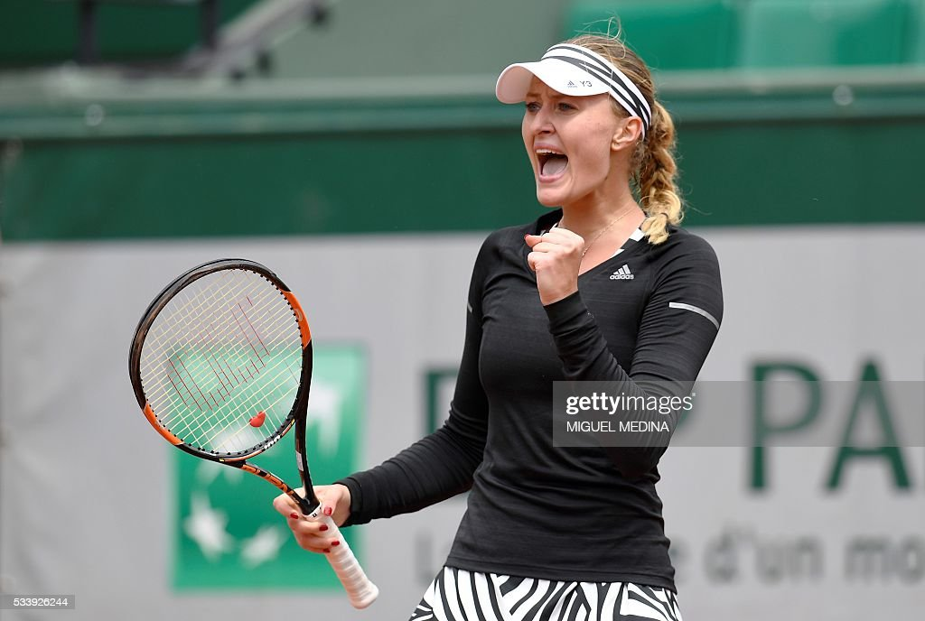 France's Kristina Mladenovic reacts after winning a point against Italy's Francesca Schiavone during their women's first round match at the Roland Garros 2016 French Tennis Open in Paris on May 24, 2016. / AFP / MIGUEL