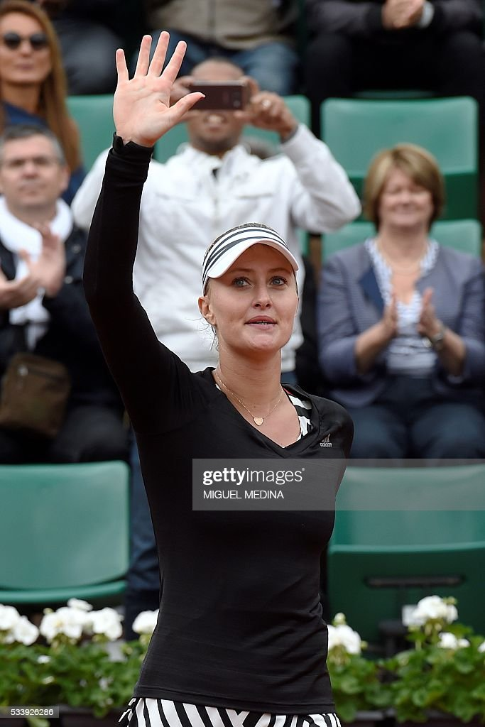 France's Kristina Mladenovic reacts after winning against Italy's Francesca Schiavone during their women's first round match at the Roland Garros 2016 French Tennis Open in Paris on May 24, 2016. / AFP / MIGUEL