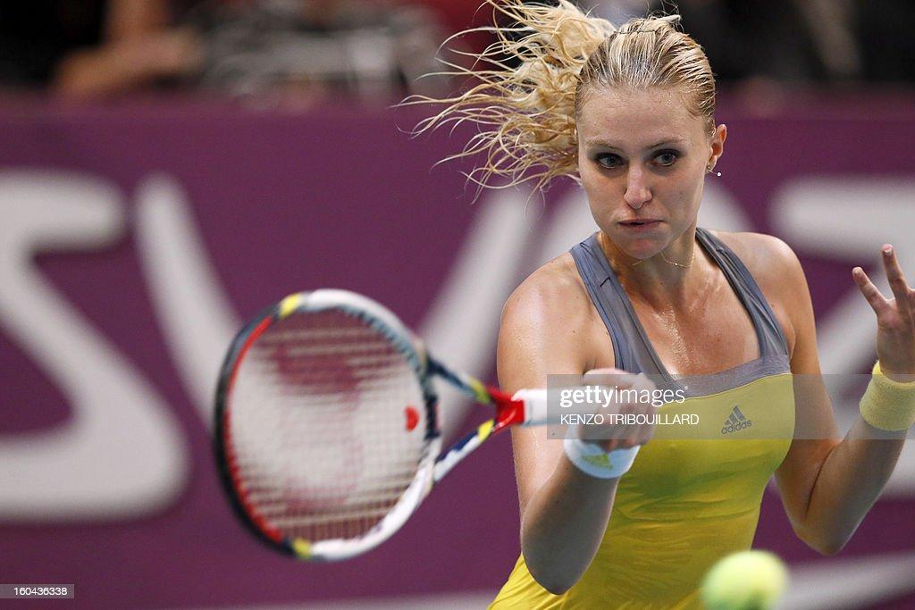 France's Kristina Mladenovic returns a shot to Belgium's Yanina Wickmayer during their 21st Paris WTA Open tennis match on January 31, 2013, in Paris.