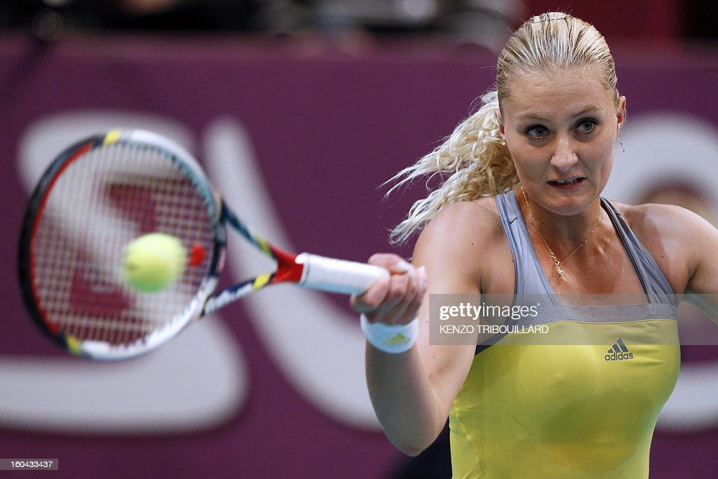 France's Kristina Mladenovic returns the ball to Belgium's Yanina Wickmayer on January 31, 2013 during the second round of the 21st Paris Open in Paris. AFP PHOTO / KENZO TRIBOUILLARD