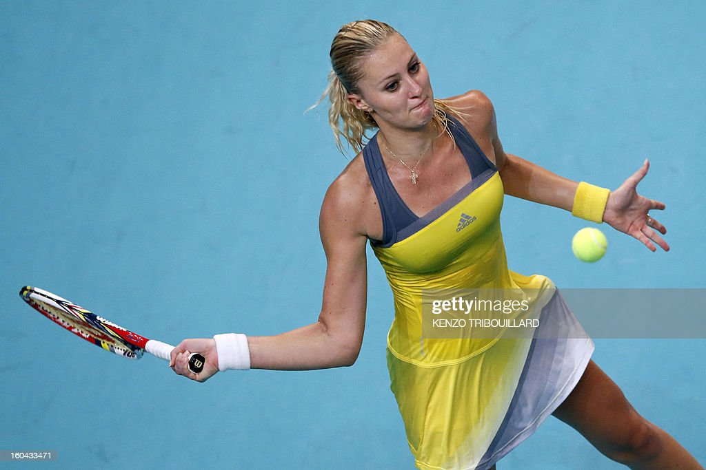 France's Kristina Mladenovic returns the ball to Belgium's Yanina Wickmayer on January 31, 2013 during the second round of the 21st Paris Open in Paris.