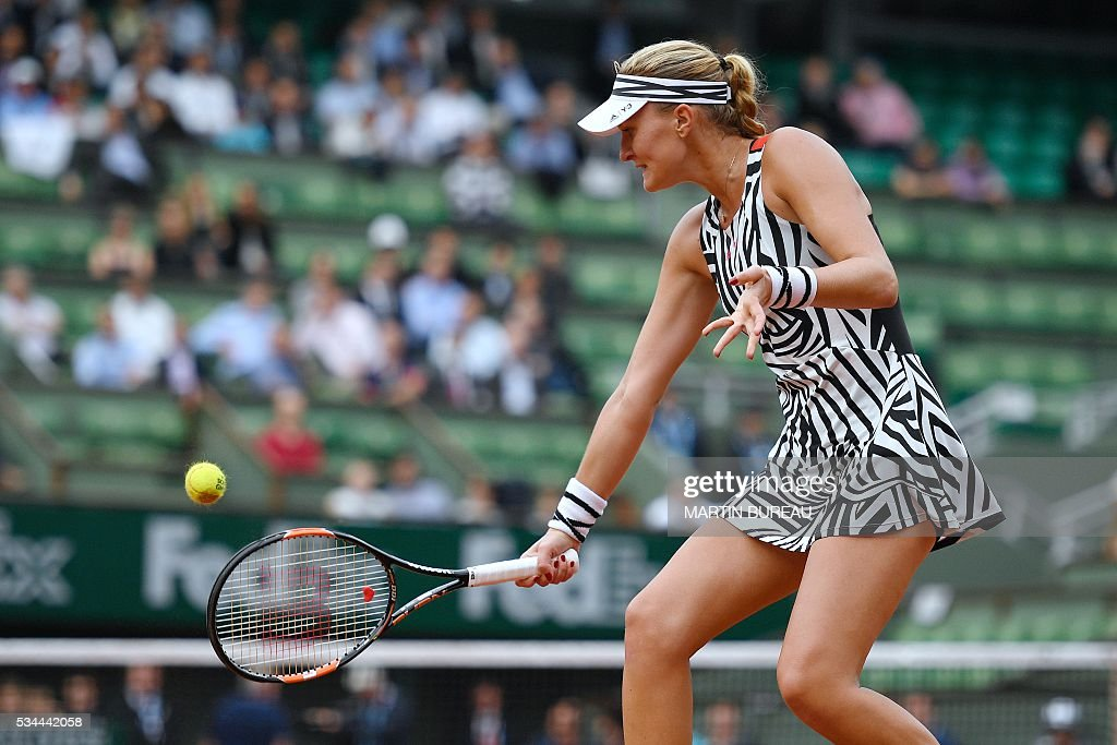 France's Kristina Mladenovic returns the ball to Hungary's Timea Babos during their women's second round match at the Roland Garros 2016 French Tennis Open in Paris on May 26, 2016. / AFP / Martin BUREAU