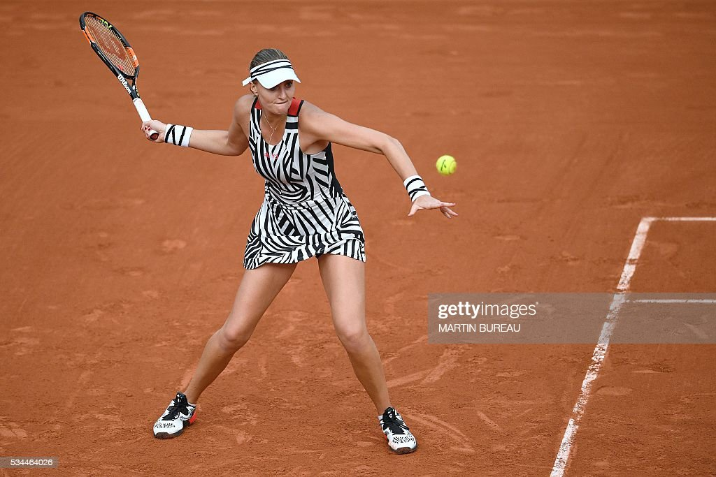 France's Kristina Mladenovic returns the ball to Hungary's Timea Babos during their women's second round match at the Roland Garros 2016 French Tennis Open in Paris on May 26, 2016. / AFP / MARTIN