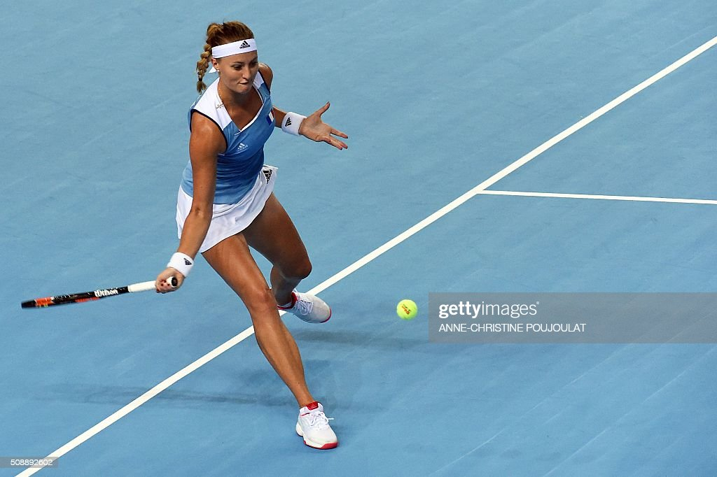 France's Kristina Mladenovic returns the ball to Italy's Sara Errani during the Federation Cup tennis world group first round match between France and Italy in Marseille, southern France, on February 7, 2016. / AFP / ANNE-CHRISTINE POUJOULAT