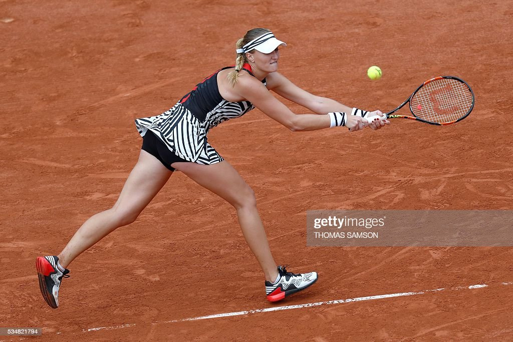 France's Kristina Mladenovic returns the ball to US player Serena Williams during their women's third round match at the Roland Garros 2016 French Tennis Open in Paris on May 28, 2016. / AFP / Thomas SAMSON