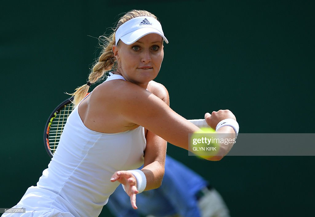 France's Kristina Mladenovic returns to Belarus's Aliaksandra Sasnovich during their women's singles first round match on the fourth day of the 2016 Wimbledon Championships at The All England Lawn Tennis Club in Wimbledon, southwest London, on June 30, 2016. / AFP / GLYN