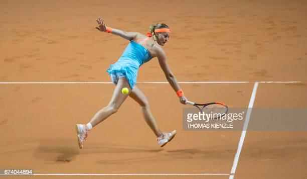 France's Kristina Mladenovic returns to Germany's Angelique Kerber in their second round match at the WTA Porsche Tennis Grand Prix in Stuttgart...