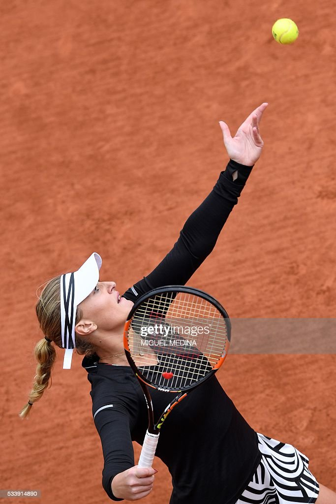 France's Kristina Mladenovic serves the ball to Italy's Francesca Schiavone during their women's first round match at the Roland Garros 2016 French Tennis Open in Paris on May 24, 2016. / AFP / MIGUEL