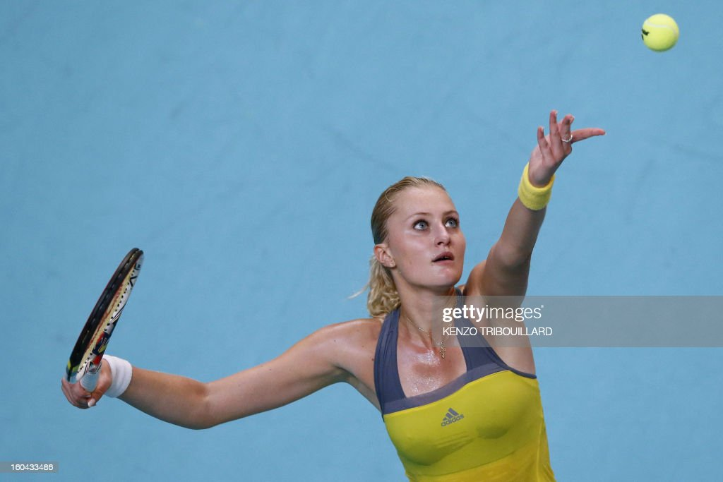 France's Kristina Mladenovic serves to Belgium's Yanina Wickmayer at the 21st edition of the Paris WTA Open on January 31, 2013. AFP PHOTO KENZO TRIBOUILLARD