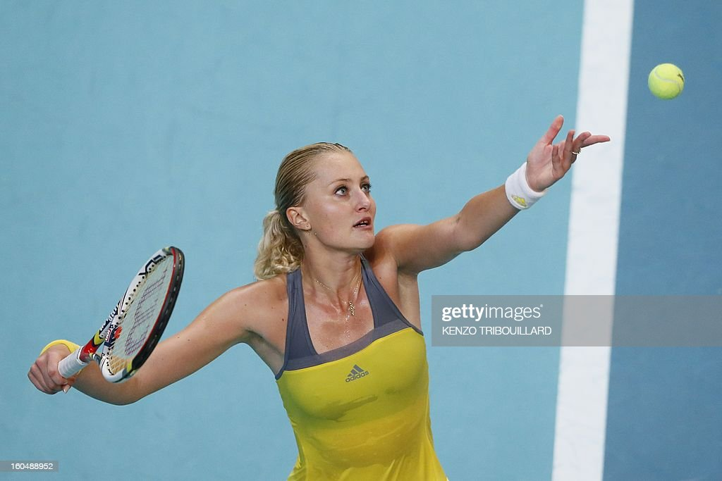 France's Kristina Mladenovic serves to Czech Republic's Petra Kvitova during their tennis match as part of the 21st edition of the Paris WTA Open on February 1, 2013. AFP PHOTO KENZO TRIBOUILLARD