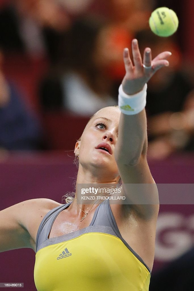 France's Kristina Mladenovic serves to Czech Republic's Petra Kvitova during their tennis match as part of the 21st edition of the Paris WTA Open on February 1, 2013.