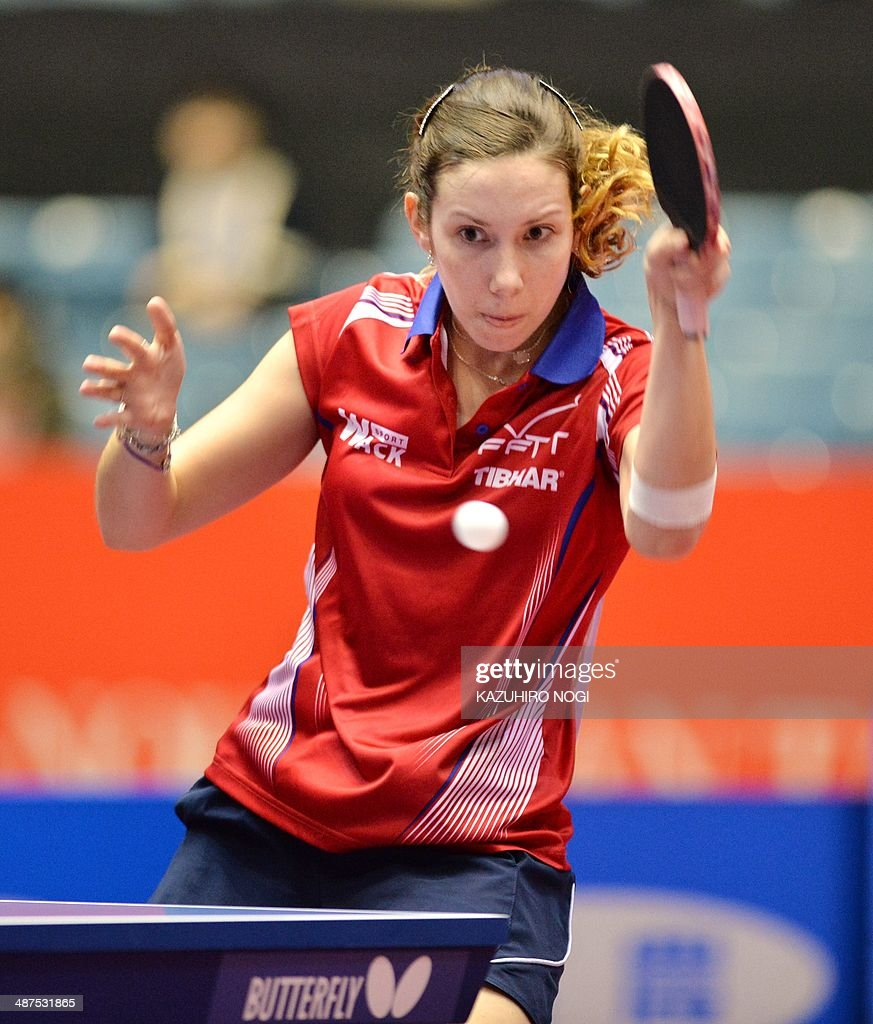 France's Laura Gasnier returns a shot against Singapore's Li Isabelle Siyun during their match in the women's team championship division group C at the 2014 World Team Table Tennis Championships in Tokyo on May 1, 2014.