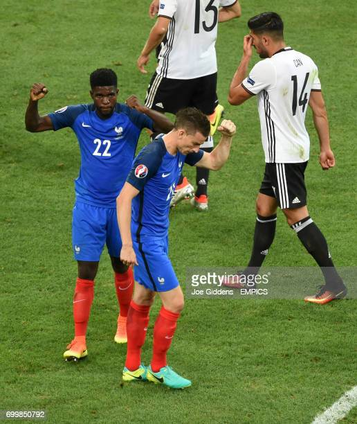 France's Laurent Koscielny and Samuel Umtiti react after seeing tehir side win a penalty