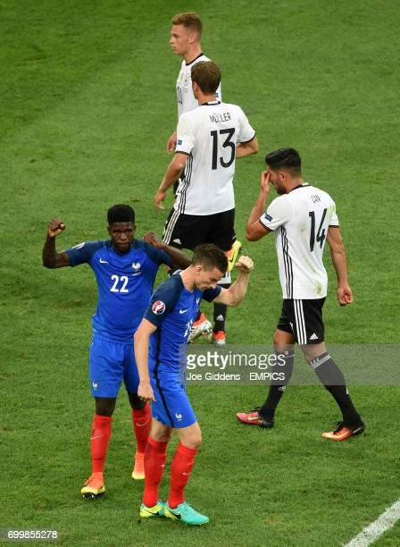 France's Laurent Koscielny and Samuel Umtiti react after seeing their side win a penalty