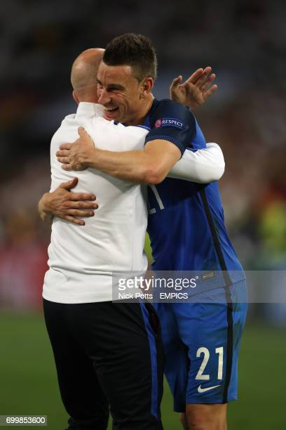 France's Laurent Koscielny celebrates after the final whistle