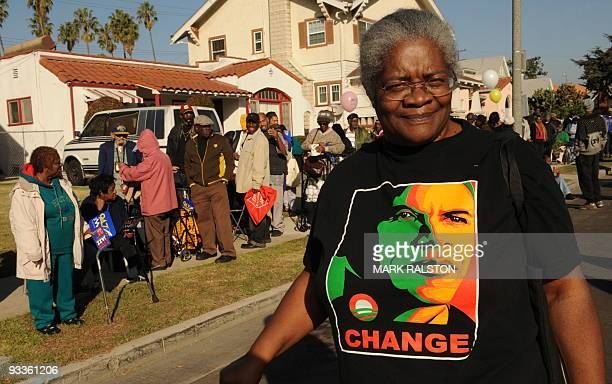 Frances Leake wears a President Obama 'Change' tshirt as she walks past a group of lowincome and needy people who are amongst the 10000 people lined...