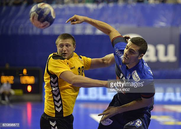 France's left back Mathieu Grebille vies with Lithuania's right back Mindaugas Dumcius as he attempts a shot on goal during the 2018 EHF Men's...