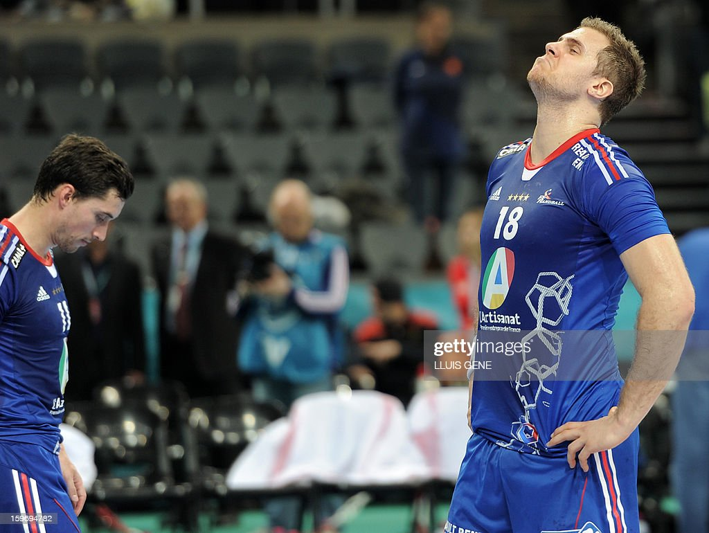 France's left back William Accambray (R) and France's left wing Samuel Honrubia (L) react after the 23rd Men's Handball World Championships preliminary round Group A match France vs Germany at the Palau Sant Jordi in Barcelona on January 18, 2013. Germany won 32-30.