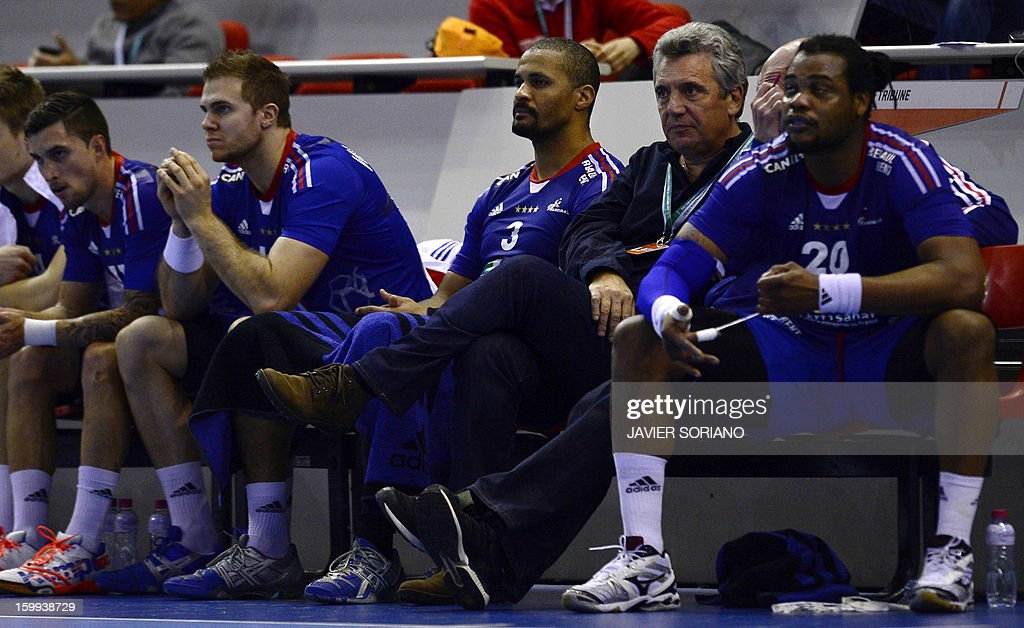 France's left back William Accambray, pivot Didier Dinart, France's coach Claude Onesta and France's pivot Cedric Sorhaindo react during the 23rd Men's Handball World Championships quarterfinal match France vs Croatia at the Pabellon Principe Felipe in Zaragoza on January 23, 2013. Croatia won 30-23.