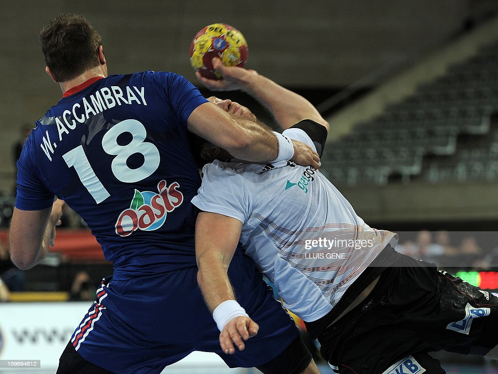France's left back William Accambray (L) vies with Germany's right wing Steffen Weinhold (R) during the 23rd Men's Handball World Championships preliminary round Group A match France vs Germany at the Palau Sant Jordi in Barcelona on January 18, 2013.