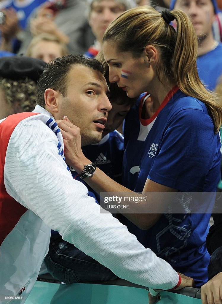 France's left wing Jerome Fernandez talks with his wife Stephanie after the 23rd Men's Handball World Championships preliminary round Group A match France vs Germany at the Palau Sant Jordi in Barcelona on January 18, 2013. Germany won 32-30.