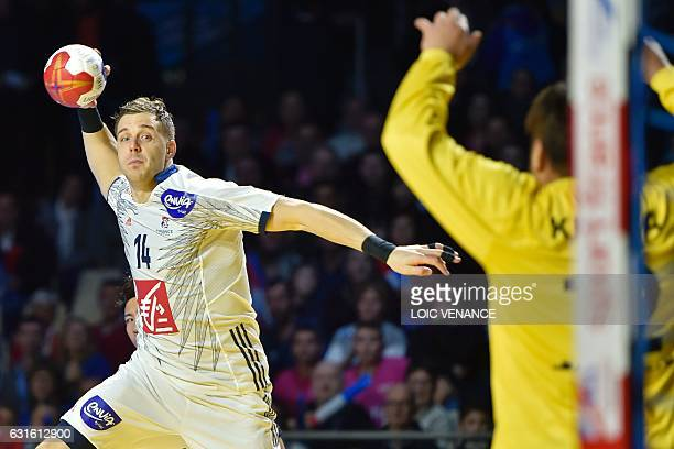 France's left wing Kentin Mahe jumps to shoot during the 25th IHF Men's World Championship 2017 Group A handball match Japan vs France on January 13...