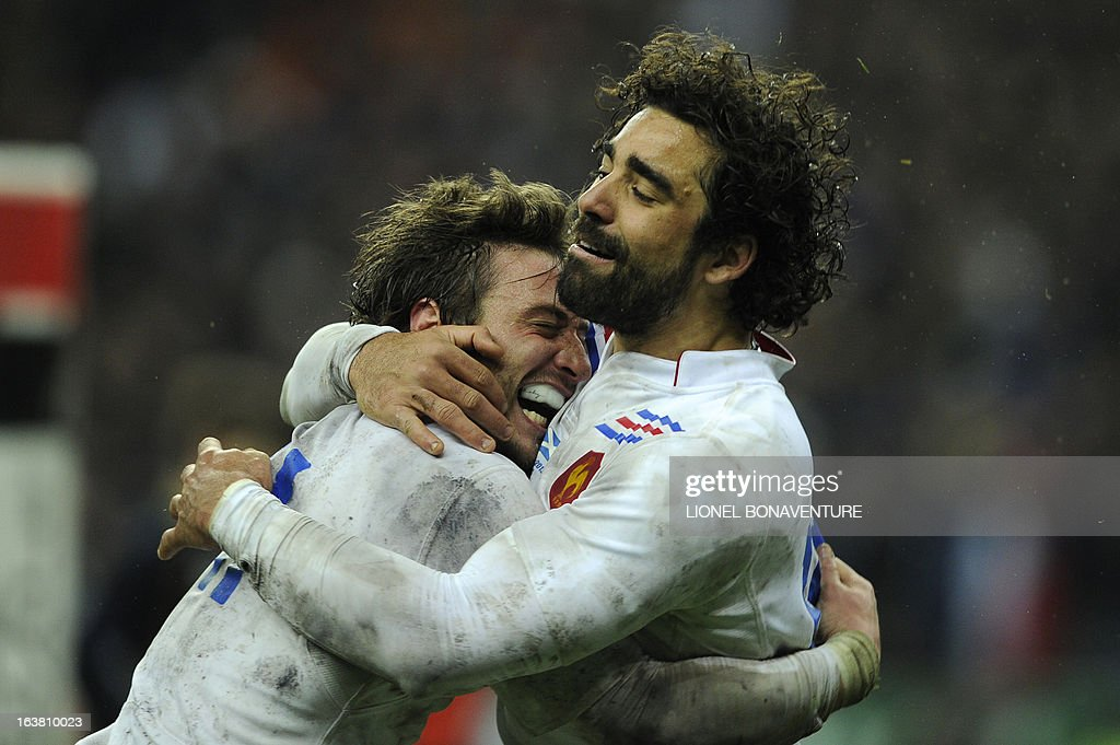 France's left wing Maxime Medard (L) and France's full back Yoann Huget celebrates after scoring during the Six Nations International Rugby Union match between France and Scotland at the Stade de France, in Saint-Denis, near Paris on March 16, 2013.