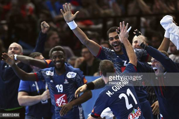 TOPSHOT France's left wing Michael Guigou celebrates a goal with teammates on the bench during the 25th IHF Men's World Championship 2017 final...