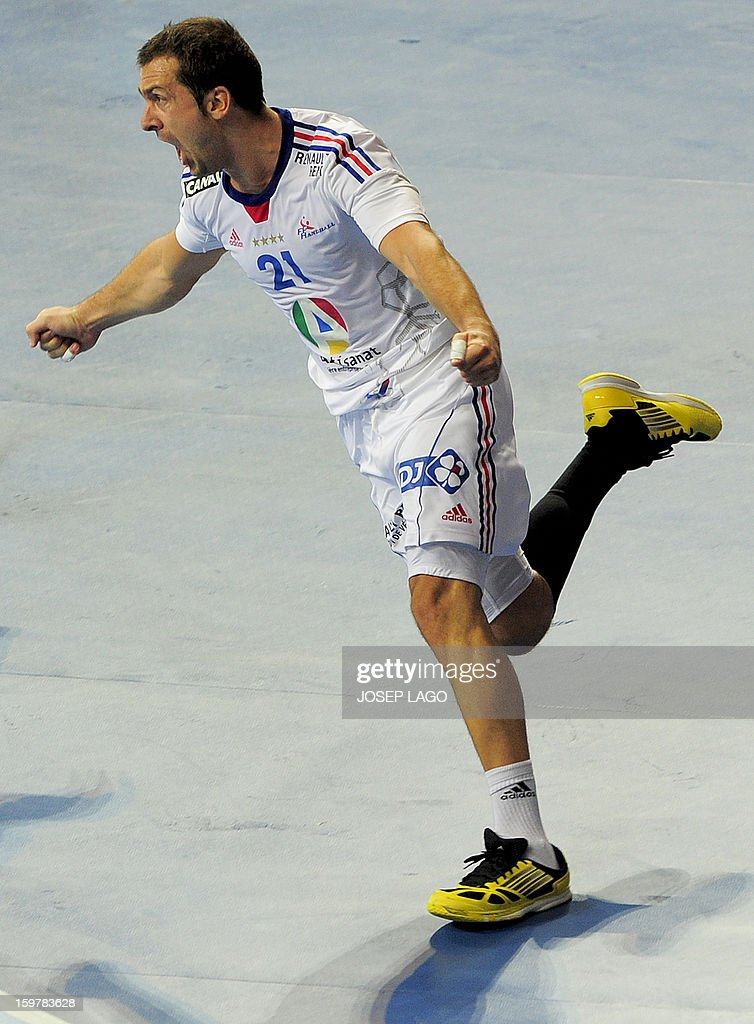 France's left wing Michael Guigou celebrates after scoring during the 23rd Men's Handball World Championships round of 16 match Iceland vs France at the Palau Sant Jordi in Barcelona on January 20, 2013. AFP PHOTO/ JOSEP LAGO