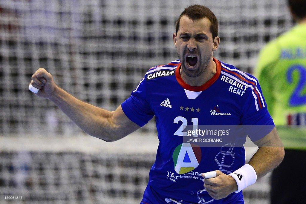 France's left wing Michael Guigou celebrates after scoring during the 23rd Men's Handball World Championships quarterfinal match France vs Croatia at...