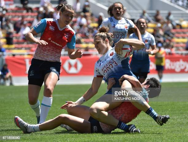 France's Lenaig Carson is tackled by Russia's Baizat Khamidova during their fifth place semifinals at the World Rugby Women's Seven Series in...