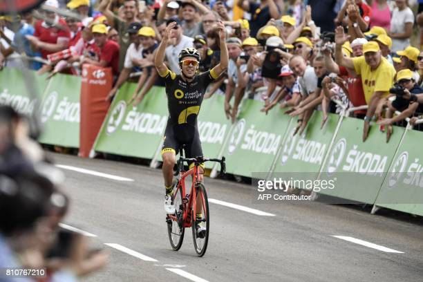 France's Lilian Calmejane celebrates as he crosses the finish line at the end of the 1875 km eighth stage of the 104th edition of the Tour de France...