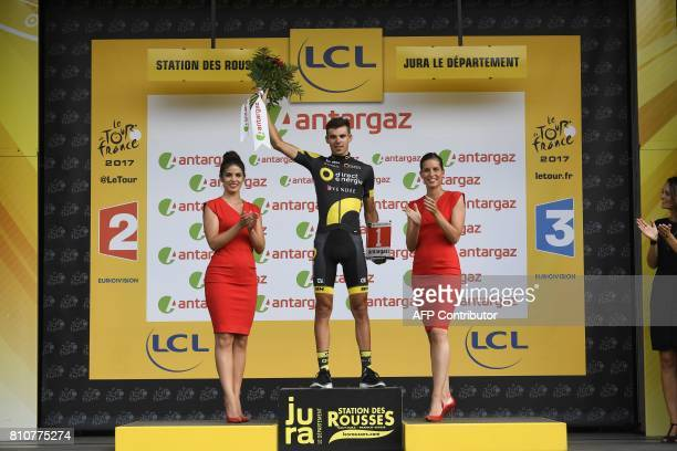 France's Lilian Calmejane celebrates his combativity prize on the podium at the end of the 1875 km eighth stage of the 104th edition of the Tour de...