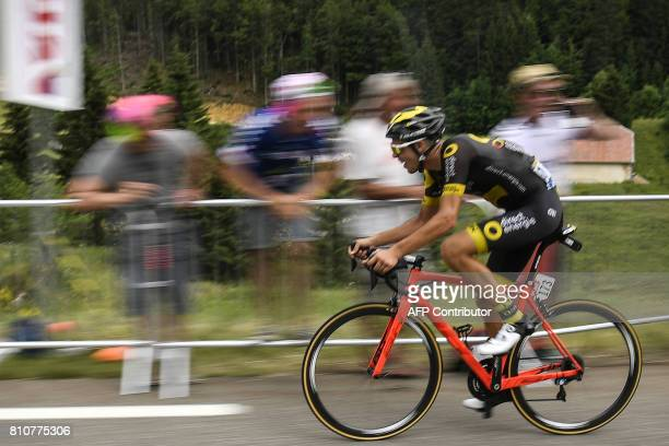 France's Lilian Calmejane climbs the last hill in a breakaway as supporters cheer during the 1875 km eighth stage of the 104th edition of the Tour de...