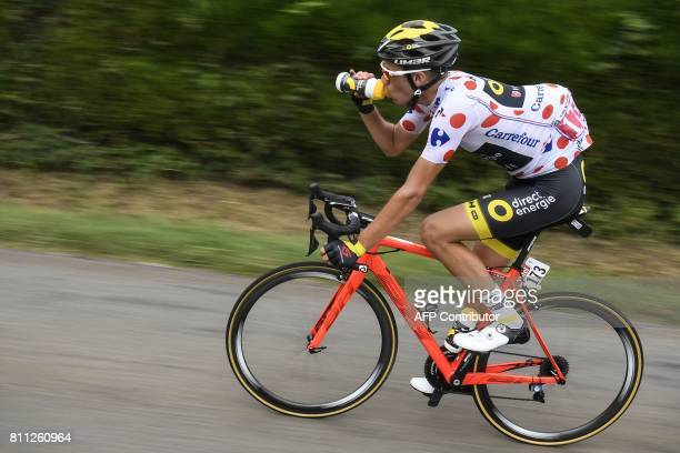 France's Lilian Calmejane wearing the best climber's polka dot jersey drinks as he rides during the 1815 km ninth stage of the 104th edition of the...