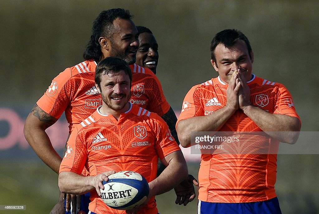 France's lock Jocelino Suta, France's winger Marc Andreu and France's tight head prop Nicolas Mas joke during a training session in Marcoussis, south of Paris, on March 17, 2015 ahead of the Six Nations rugby union match between France and England.