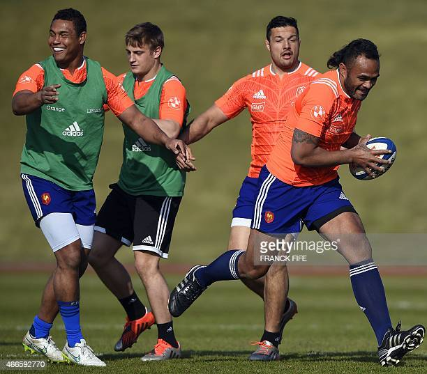 France's lock Jocelino Suta runs with a ball past France's captain Thierry Dusautoir France's flyhalf Jules Plisson and France's number eight Damien...
