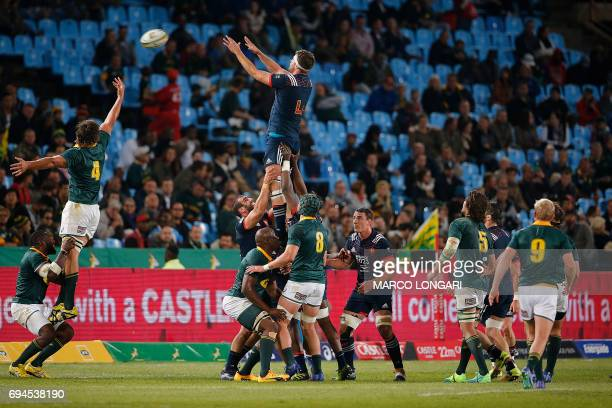 France's lock Julien Le Devedec reaches out for the ball in a line ou during the first rugby union Test match between South Africa and France at the...