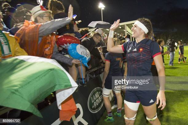 France's lock Lenaig Corson celebrates with supporters after the Women's Rugby World Cup 2017 pool C rugby match between France and Ireland at The...