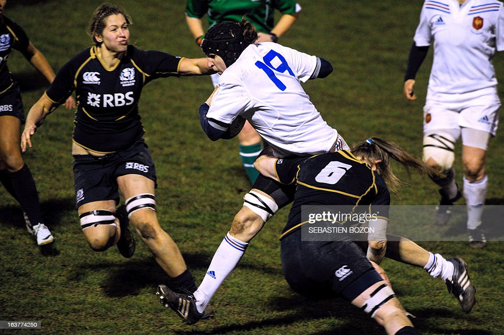 France's lock Lenaig Corson (C) is tackled on March 15, 2013 by Scotland's flanker Jade Konkel (R) during the Six Nations women's international rugby union match between France and Scotland at the Bourillot Stadium in Longvic, eastern France.