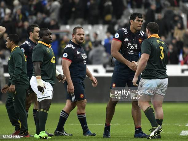 France's lock Sebastien Vahaamahina shakes hands with South Africa's prop Wilco Louw after the friendly rugby union international Test match between...